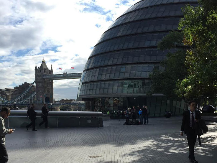 London City hall in front of London Bridge on a sunny day