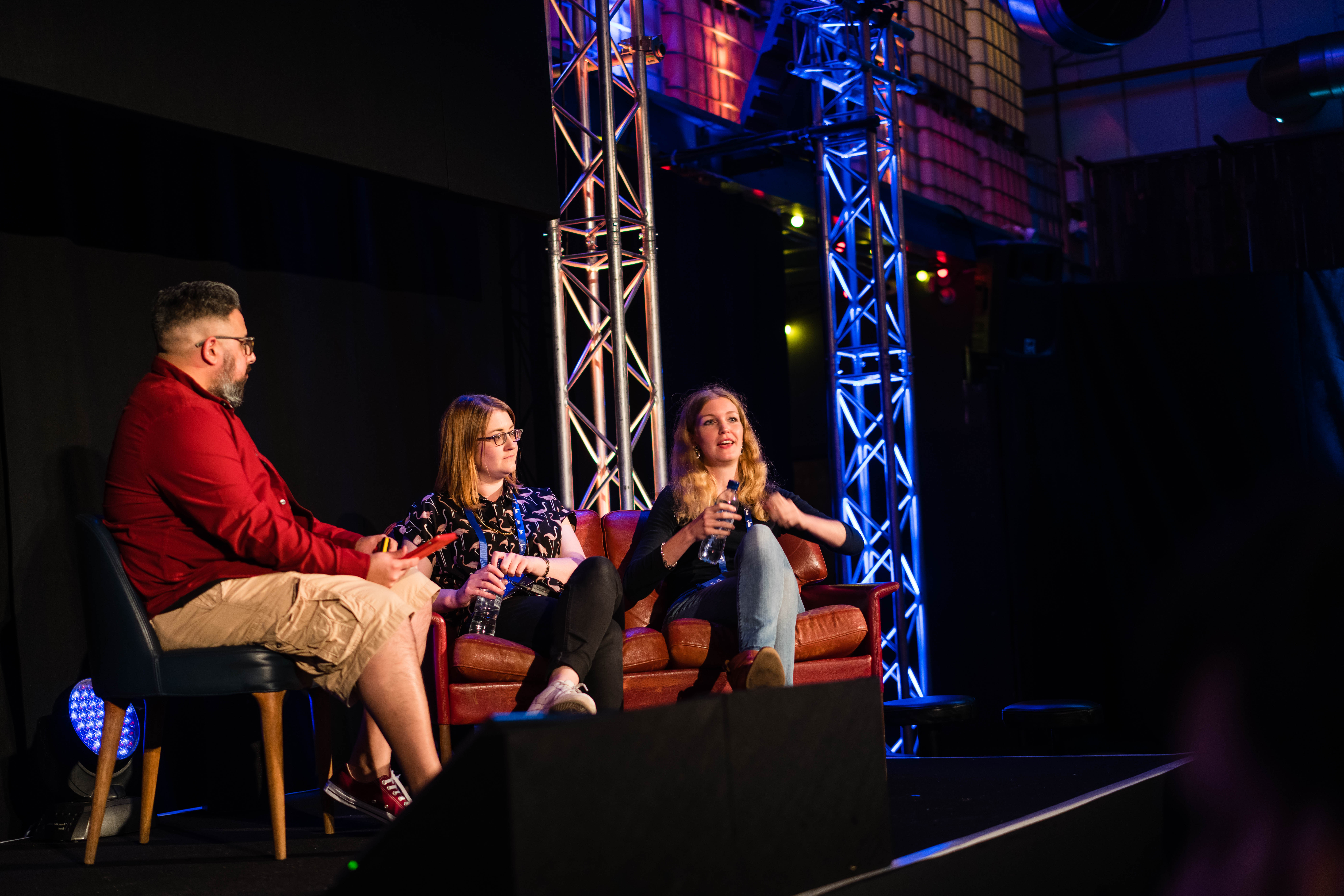 Three people talk on stage at the JAM 2017 event