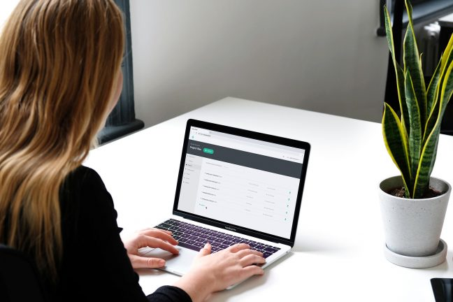 A person uses a document portal on a laptop