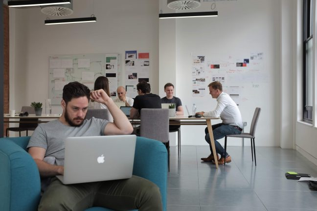 The Browser team work in their open plan office in Shoreditch, London
