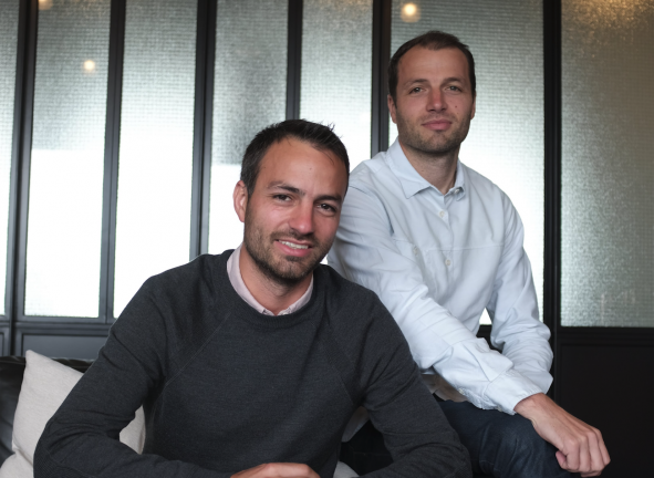 Rene and Julian, founders of Browser London, sit and smile at the camera