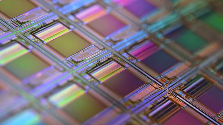 A silicon wafer full of colourful CPU dies